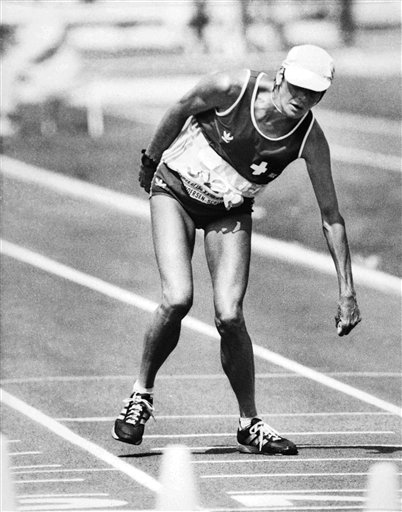 Gabriela Andersen-Scheiss, suffering from heat exhaustion, staggers to the finish line of the 1984 Olympic women's marathon in the Los Angeles Coliseum, Sunday, Aug. 5, 1984. Andersen-Scheiss finally crossed the line in 37th place, and collapsed into the arms of waiting medics. (AP Photo/David Tenenbaum)