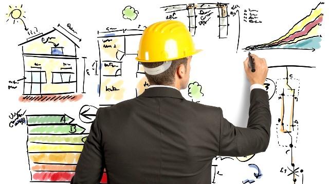 Imagem de engenheiro de costas, desenhando imagens que remetem ao desenvolvimento, como construção, casas, gráficos