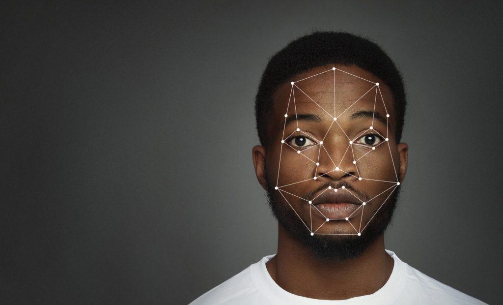 imagem ilustrativa de rosto negro mapeado com pontos para inteligencia artificial, para ilustrar que software de reconhecimento facial falha twitter