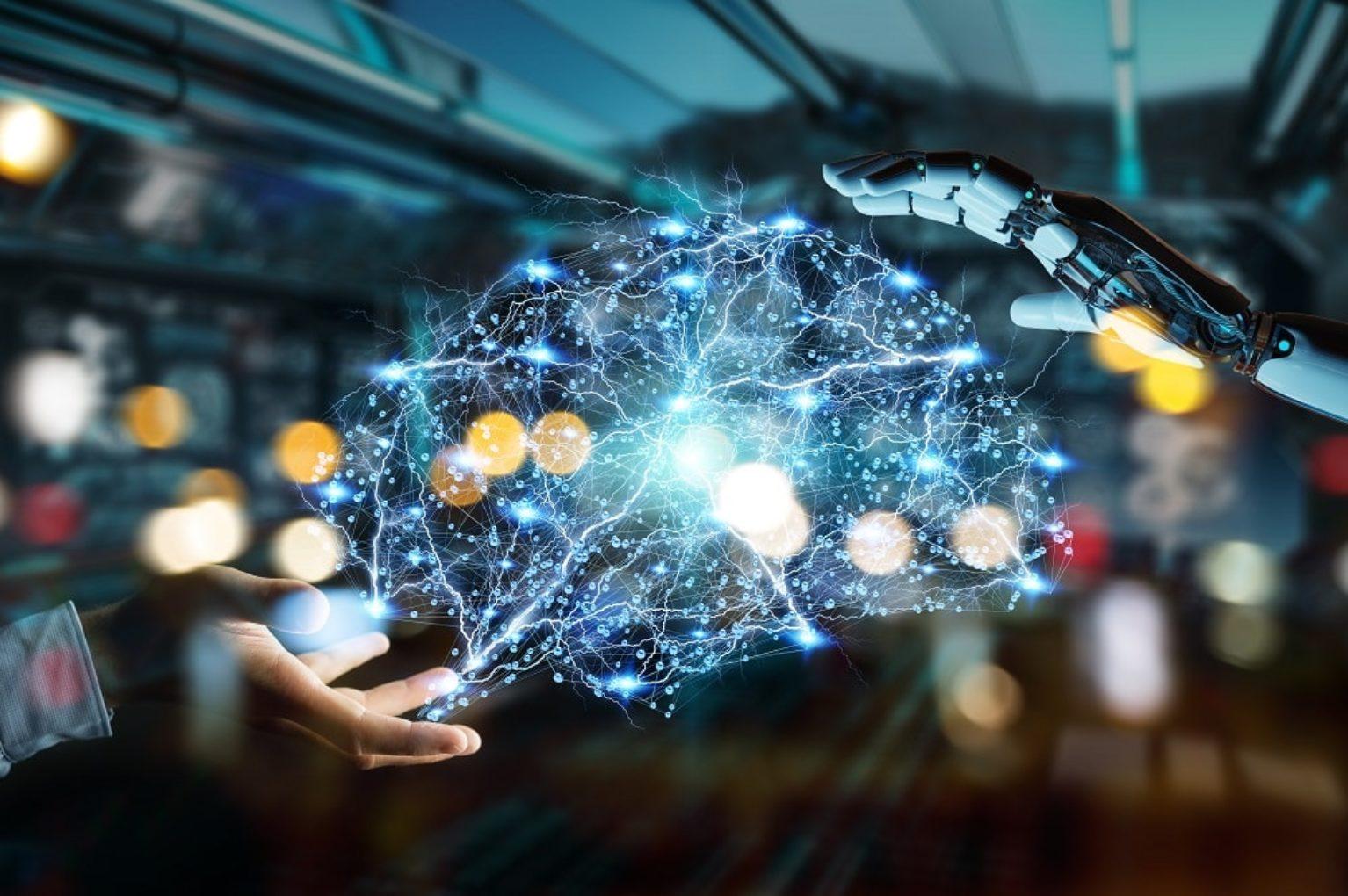 imagem de mão e robô se conectando inteligência artificial