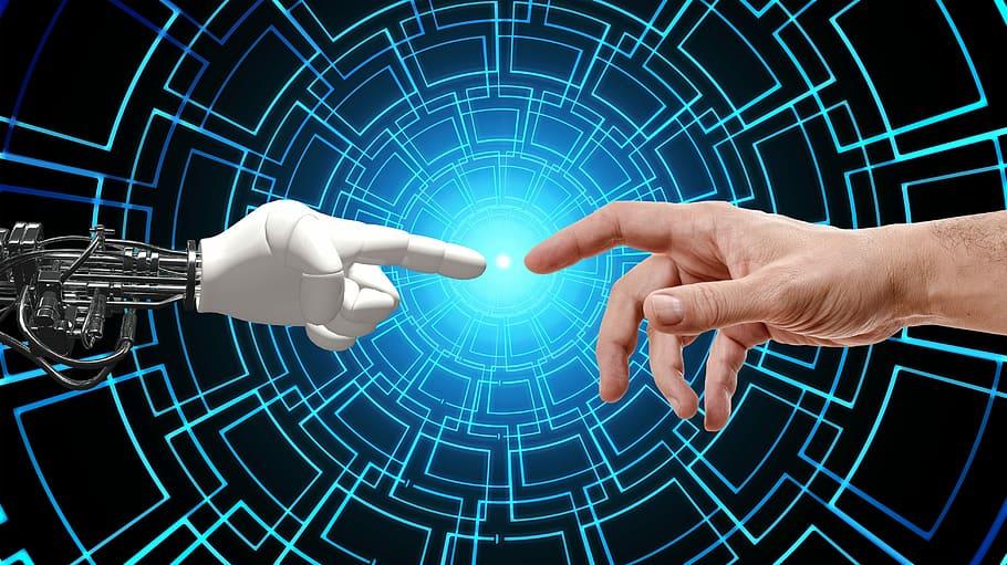 Computadores podem ter emoções? Imagem representando uma mão robótica e uma mão humana se tocando. Fonte: pxfuel.com