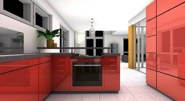 Simulação de ambientes em softwares de computador usando tecnologia. Ambiente é uma cozinha em tons vermelhos.