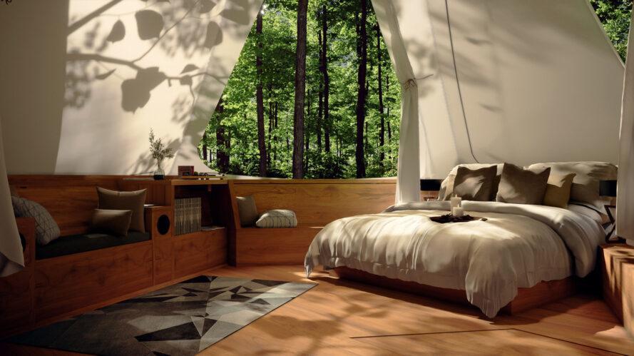 interior do projeto, com uma cama de casal, tapete e poltrona
