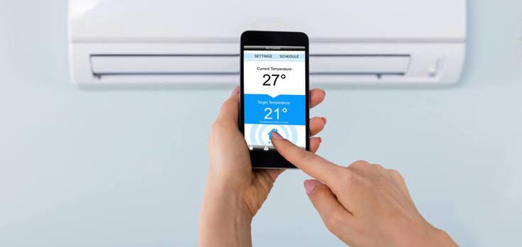Controle via celular de ar condicionado ilustrando climatização do ambiente